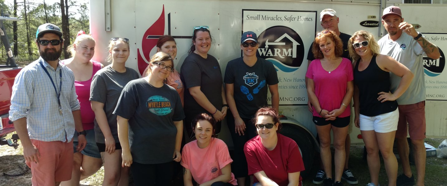 Our Story–CastleBranch Team members volunteering with WARM